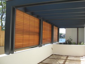 Three Cedar Retractable Venetians Blinds operated manually with a crank handle