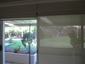Face Fit Blockout Roman Blinds with Reveal Fit Screen Roller Blinds behind