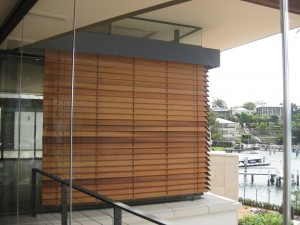 Two Cedar Retractable Venetian Blinds on a corner window