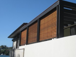 Three Cedar Retractable Blinds operated by a crank handle